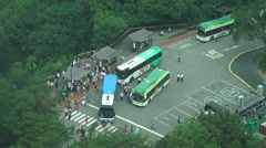 Aerial View of Tour Buses And Tourist Stock Footage