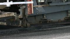 Asphalt paver machine on the road construction work site Stock Footage