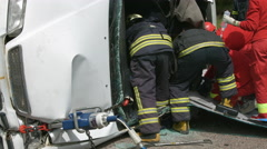 paramedics help a victim of the car accident - stock footage