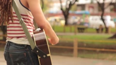 Guitarist playing in a public area of Cali, Colombia Stock Footage
