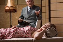 Psychoanalyst talking with despair woman - stock photo