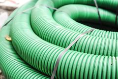 Flexible plastic tube green Stock Photos