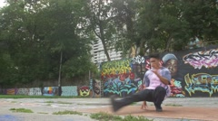 Extreme Break Dancing - Professional dancer laying down routine in urban setting Stock Footage