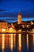 Old town of Trogir in Dalmatia, Croatia by night. - stock photo