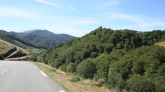Car riding on Basque country road - stock footage