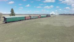 Сatch up and overtaking old steam train Stock Footage