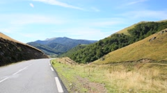 Car riding on Basque country road Stock Footage