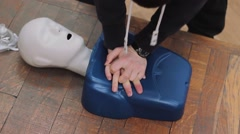 Stock Video Footage of The rescuer does chest compressions. First Aid. Training of Lifeguards.