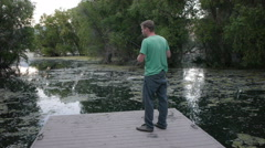 Fishing form the docks, single person Stock Footage