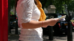 Close up of a tourist woman looking at a map of London, United kingdom Stock Footage