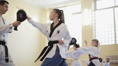 The training process of preparing children for competitions in Taekwondo - stock footage