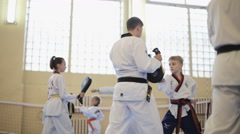 The training process of preparing children for competitions in Taekwondo Stock Footage