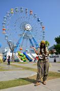 Thai women portrait at santorini amusement park - stock photo