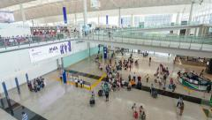 4k hyperlapse video of travellers in the arrival hall of an airport Stock Footage