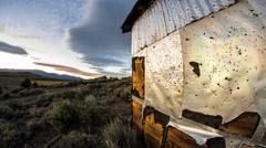 4K Abandoned Steel Shed Sunset Sunrise Desert Time-lapse Stock Footage