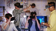 4K Group of young male computer gamers immersed in a virtual reality game Stock Footage