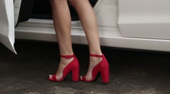 Lady legs with red high heel shoes Stock Footage