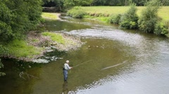 Upper view of fly-fisherman fishing in river, basque country - stock footage