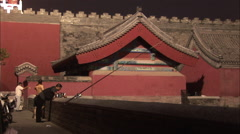 Chinese men fishing outside Forbidden City Stock Footage