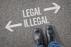 Decision at a crossroad - Legal or Illegal Stock Photos