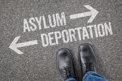 Decision at a crossroad - Asylum or Deportation - stock photo