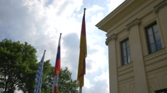 Three flags in front of the Prinz-Carl-Palais, Munich Stock Footage