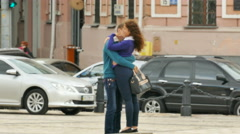 KIEV CITY,UKRAINE – 07 September 2015:  Young pair kisses on  city street Stock Footage