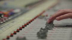 Close-up hands of sound engineer work with faders on mixer Stock Footage
