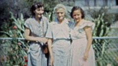 1953: Grown up daughters share a moment with senior citizen mother. Stock Footage