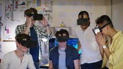 4K Portrait of smiling computer programmers trying out virtual reality viewers - stock footage