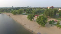 Aerial shot beach with park in background - stock footage