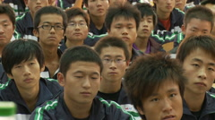 Young Chinese men in lecture hall, China Stock Footage