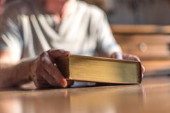 Man holding the Bible - stock photo