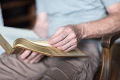 Man reading the Bible - stock photo