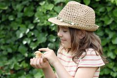 happy little girl holding cute little chicken - stock photo