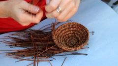 Weaving a vase of pine needles Stock Footage