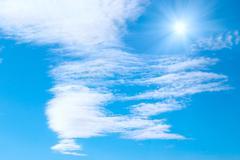 Sun, clouds and sky Stock Photos