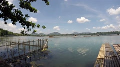 Lake fish cages and bamboo raft. tracking shot Stock Footage