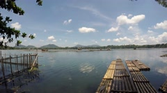 Lake fish cages and bamboo raft. tracking shot - stock footage