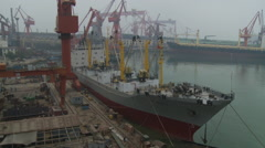 Ship in harbor, dockyard cranes, China Stock Footage
