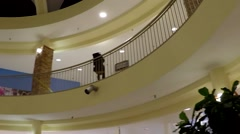 Shopper inside shopping mall with wide angle shot Stock Footage