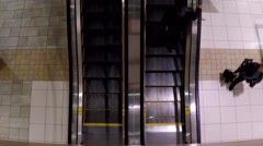 Escalators with shopper coming to lougheed mall shopping center Stock Footage