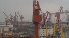 Harbor, dockyard cranes, Dalian Port, China - stock footage