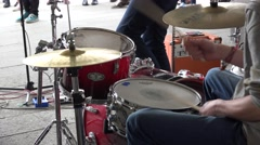 Drummer of rock men band and young people audience have fun. 4K Stock Footage