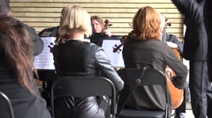 Orchestra with leader and soloist before people audience. 4K Stock Footage
