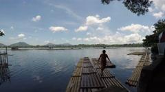 Boatman walking on bamboo raft. tracking shot Stock Footage