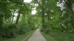 Sitting on a bench in the forest, Munich Stock Footage