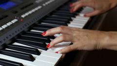 Woman playing a synthesizer Stock Footage