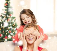 mother and daughter making a joke - stock photo