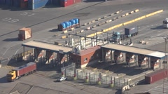4K Aerial view industrial port Barcelona truck transport border pass container  Stock Footage